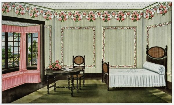 A pretty bedroom with flowery wallpaper and pink window seat. Date: 1912