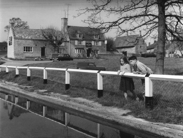 A scene by the village pond and green, showing the 'Exeter Arms ' inn, Barrowden, River Welland Valley, Rutland, England. Date: early 1960s