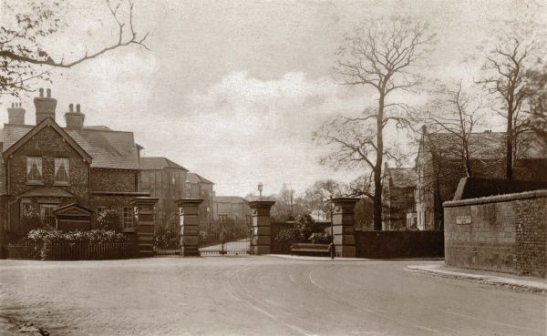 The entrance to Alder Hey Hospital, near Liverpool. A road sign on the wall at the right reads Honey's Green Lane. The hospital opened in 1915 to house chronic and bedridden patients from the West Derby Union and workhouse. During the First World War