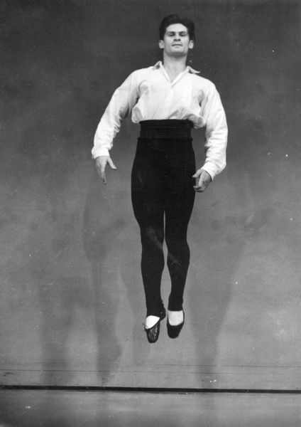 A male ballet dancer demonstrates a 'entre chats six' move. Literally translated as 'between six cats'. He crosses and uncrosses 2 feet 3 times! Date: 1930s