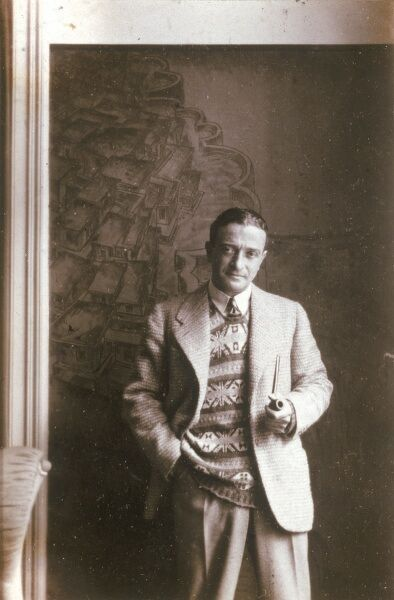 ERNST DRYDEN Poster artist, fashion pioneer and Hollywood costume designer. Holding a pipe