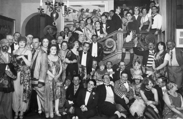 ERNST DRYDEN Poster artist, fashion pioneer and Hollywood costume designer. Fancy dress party in Vienna with Dryden pictured in the centre