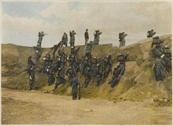 Advancing troops must overcome every obstacle : this French infantry detachment is making an escalade over a sand dune