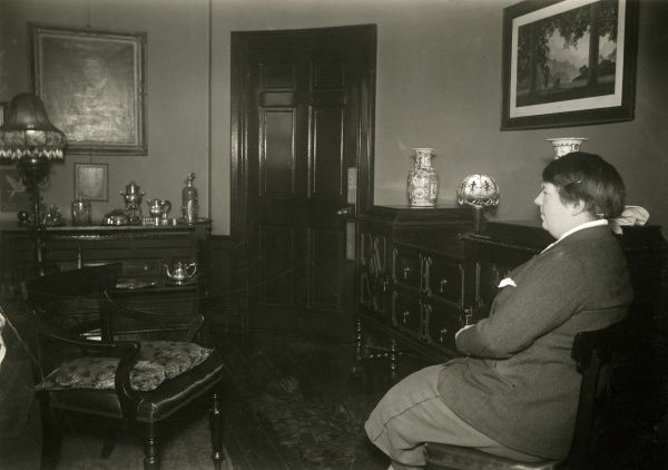 Photograph of Esson Maude recreating where she sat during sitting with the Scottish medium Helen Duncan at the sance venue in Edinburgh, January 1933