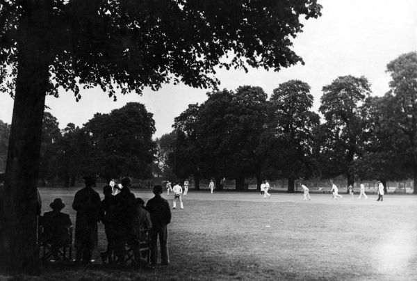 A cricket match on Eton Playing Fields, Eton public boys' school, Berkshire, England. Date: 1930s