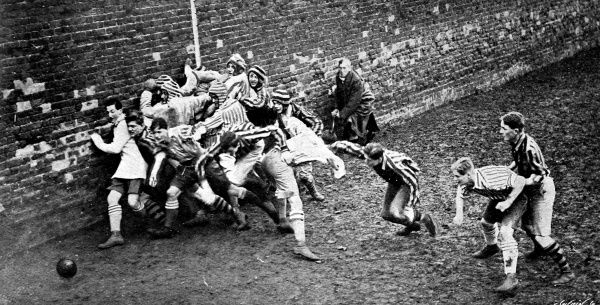 Photograph showing a Wall game between Oppidans and Collegers in progress at Eton College, on St