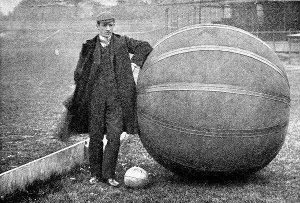 Photograph showing E.V. Hanegan, who introduced the game of 'pushball' to England (the sport was invented in the USA) in 1902. Hanegan is seen standing beside a 'pushball', which weighed 50lb, at the Crystal Palace sports ground
