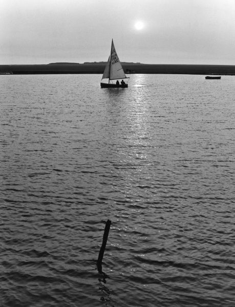 Evening dinghy sailing. Date: 1960s