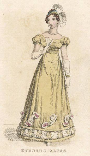 Pale yellow gown with short, puffed sleeves. The hem is decorated with 2 rouleaux infilled with 'puffings' & oval shaped designs, topped with 'paisley pattern' trim