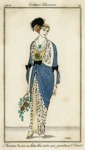 A blue satin evening mantle open to the waist & ornamented with black bows & possibly Irish lace. She wears tiara & an ostrich feather plume in her hair. N.B jade necklace. Date: 1912
