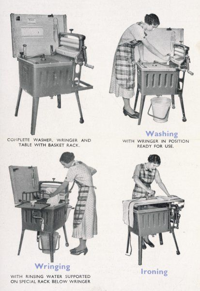 A housewife uses her Ewbank Master Clothes Washer for washing, wringing and ironing
