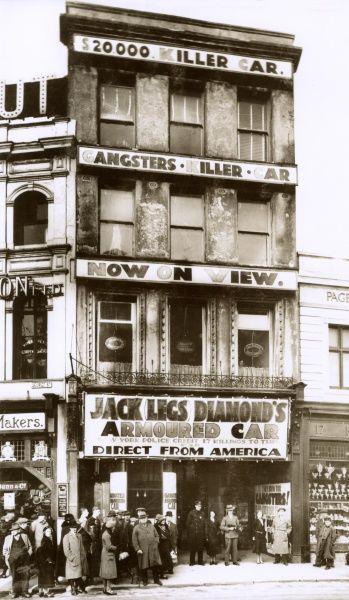 Queues awaiting entry to the exhibition of the $20,000 'Killer Car' ('Direct from New York') of American Gangster and Bootlegger Jack 'Legs' Diamond (1897-1931) opposite Derry's Clock, 16 George Street, Plymouth, Devon