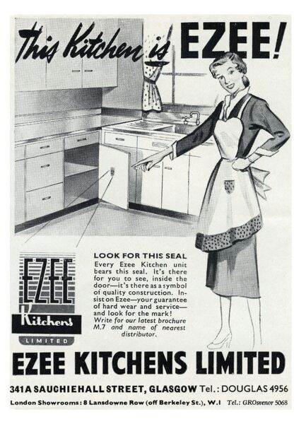 Advertisement for Ezee Kitchens featuring a proud looking housewife showing off her new kitchen units