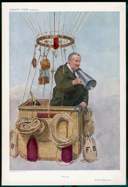 FRANK HEDGES BUTLER, noted balloonist, looks down from the hot air balloon basket he is riding in and prepares to speak through his megaphone