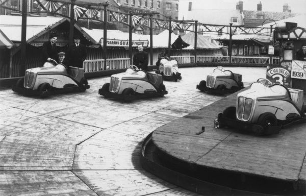A petrol car ride (owned by F Thompson), Kings Lynn (cars manufactured by R E Chambers Co., USA)