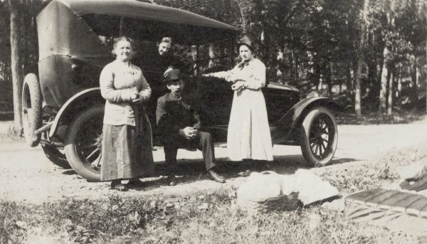 A twenties family and their car