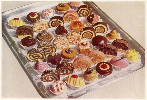 'Types of Small Fancy Pastries' - including Hazelnut Pyramids, Cherry Domes, Maraschino Rolls, Angora Tartlets, Chocolate Arches and Lulus (front row, pink) !