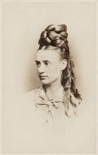 An extraordinary plaited hairdo being sported by a late 19th century woman from Dalston Junction!