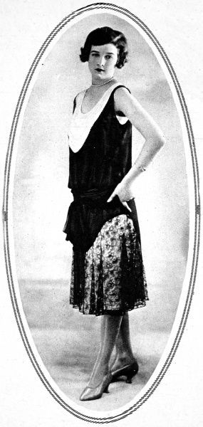 A simple dinner dress in black georgette, lined with pink, from 1927. The yoke was embroidered with fine diamante and the skirt was formed by godets of fine lace
