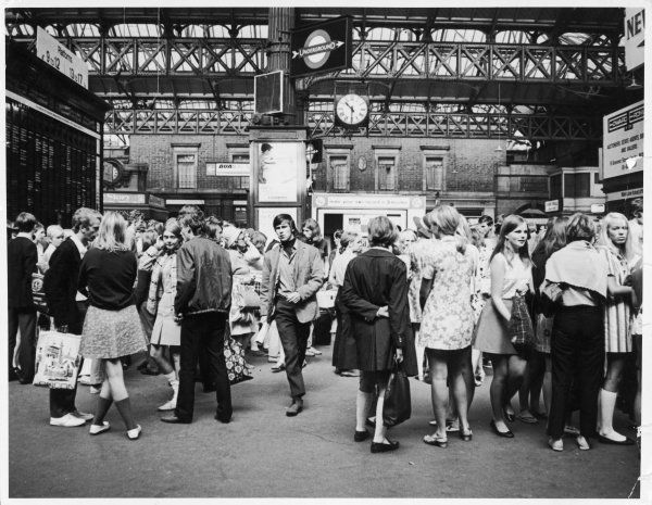 A group of trendy young people at Victoria station, London