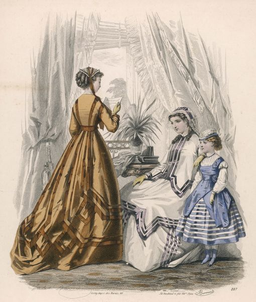 White paletot with peplum points. Girl: habit shirt with a puff at the sleeve top, skirt with pyramid trim, tunic with peplum skirt ends. N.B use of broad ribbon trimmings