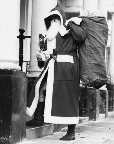 Father Christmas in the street with a sackful of presents