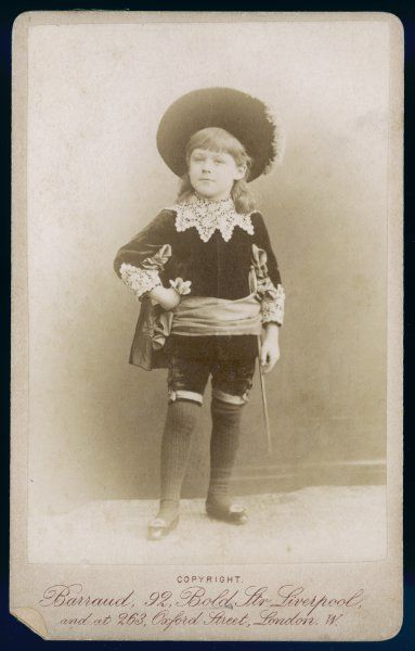 Boy in a Cavalier costume (a style which pre-dates the 1886 Hodgson Burnett novel): velvet tunic & knickerbockers, vandyked lace falling collar & cuffs, sash & cavalier hat. Date: 1889