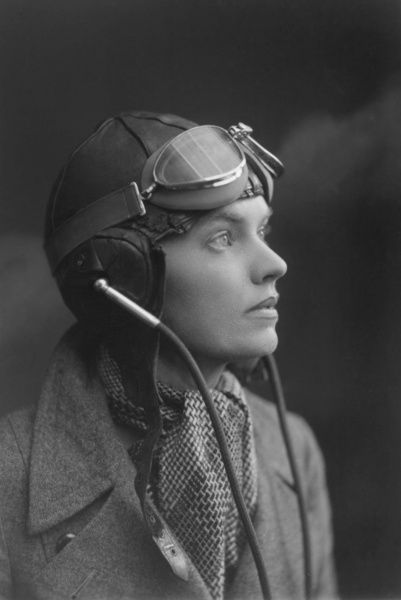 Female Aviator with flying helmet and goggles