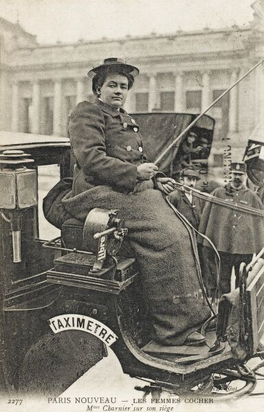 Female cab driver in Paris - Madame Charnier - holding a whip, her legs wrapped up in a warm blanket. Lady cab drivers were seen by paying customers as a far safer bet than their male counterparts and reaped the financial reward accordingly