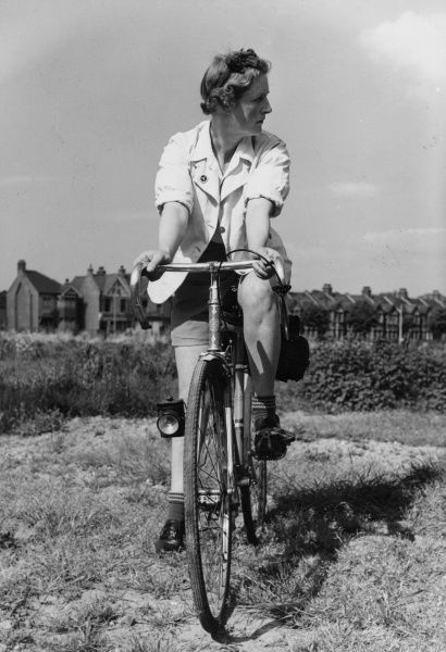 Study of a female touring cyclist, in the days when groups of young people used to tour Britain on their bicycles. Date: 1930s