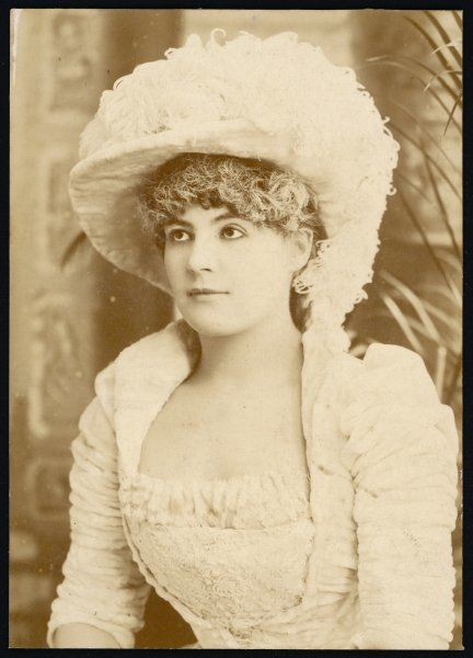 A young Victorian woman in matching hat and dress