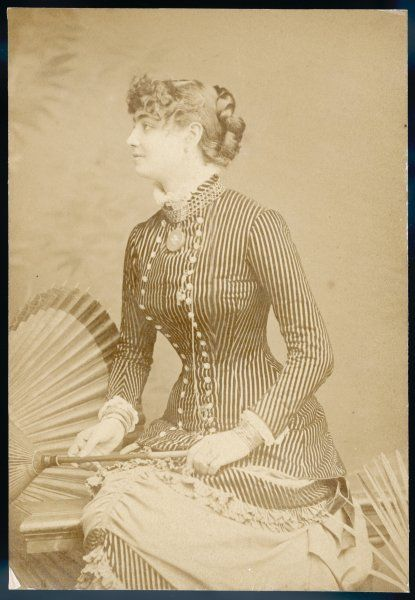 Victorian woman posing with a parasol