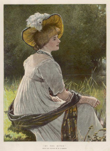 A thoughtful young Victorian woman relaxes by a river on a warm summer day