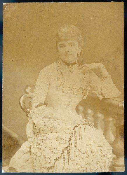 An elegant Victorian woman in a lacy dress: Mrs Wombwell