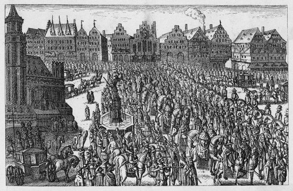 Ferdinand II is crowned Holy Roman Emperor. He is carried in procession through the streets of Frankfurt