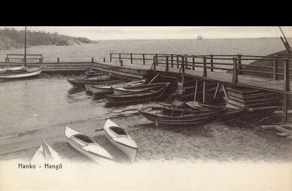 "As this card nicely describes, Hango is: ""...the great summer bathing resort of Finland. Very beautiful woods, lakes and bays in every direction."" On the southern coast of Finland, close to the border with Sweden and is bilingual as a result Date"