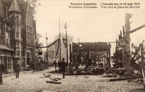 The Exposition Universelle et Internationale - a world's fair held in Brussels, Belgium in 1910 from April 2rd3 to November 1st 1910. There was a big fire on 14th and 15th August which gutted several pavilions (as seen on this postcard)