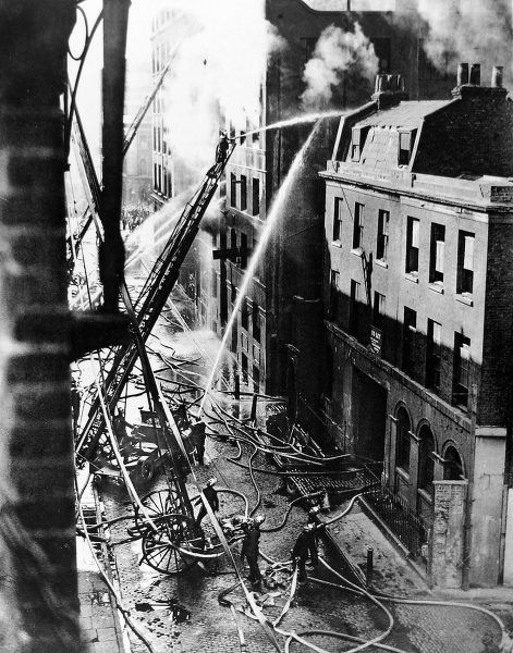 Photograph showing members of the London Fire Brigade tackling a blaze at Samuel Ward & Co.'s paint and varnish warehouse in Great Guildford Street, Southwark, August 1926