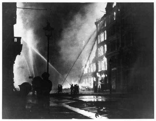 Firemen using hoses on the inferno at Eastcheap, London EC, at the height of the Blitz