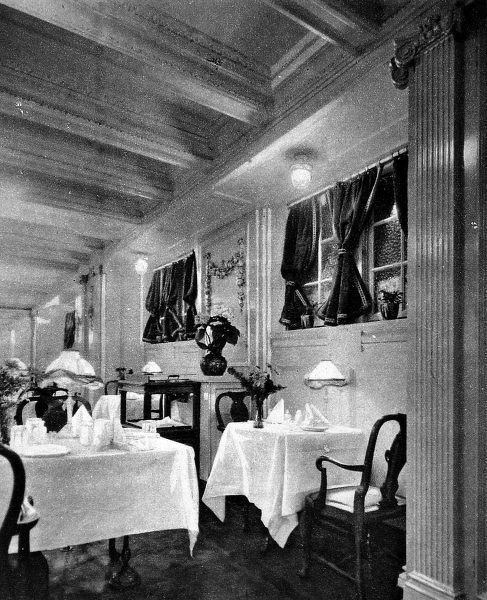 Photograph of a corner of the first-class dining saloon on board R.M.S.P. 'Almanzora', 1920. Launched in 1914, she served as an Armed Cruiser in World War I, then was reconverted into a liner. She was scrapped in 1948