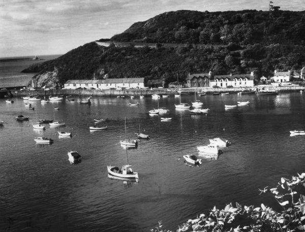 Boats in Lower Fishguard Harbour, Pembrokeshire, Wales. Date: early 1960s