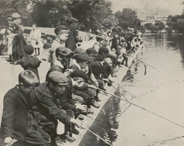 Young boys fish in St James' Park, London