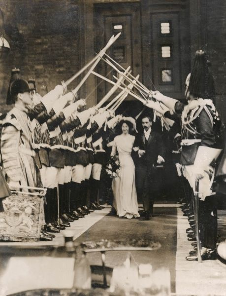 Scene at the wedding of Lord Fitzwilliam (Major Hubert Francis Fitzwilliam Brabazon Foljambe) to the Hon Gladys Bewicke-Copley, with an archway of swords provided by the Royal Horse Guards, who acted as guard of honour. They went to live in Pont Street