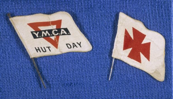 Flags sold on behalf of the YMCA and the Red Cross (possibly with St Johns, hence the unusual shape)
