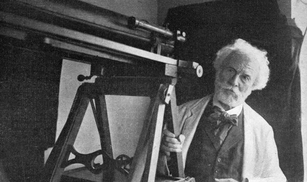 CAMILLE FLAMMARION - French astronomer, towards the end of his life, with a telescope. Date: 1842 - 1925