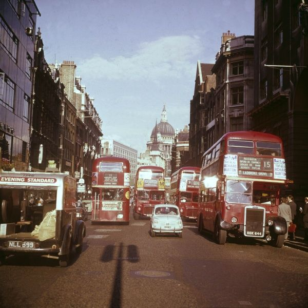 Four Routemaster buses and an Evening Standard delivery van clogging up Fleet Street during the rush hour