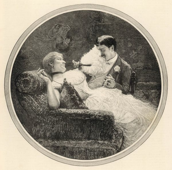 A happy couple recline on a sofa, holding hands and flirting. The woman holds out her feathery fan and strokes it over her lover's face, much to the amusement of both of them
