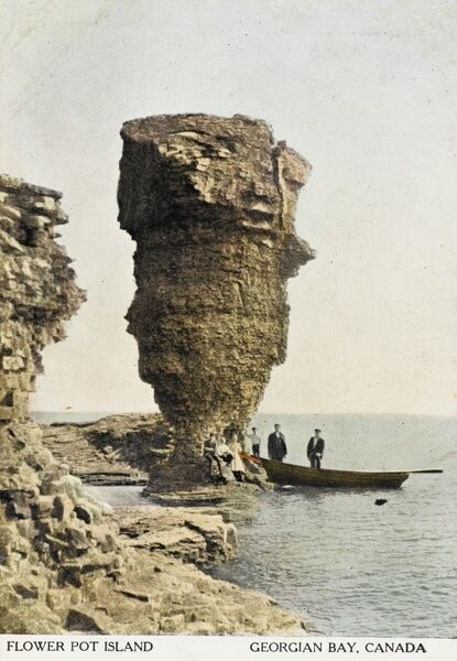 Flower Pot Island, Georgian Bay, Ontario, Canada. There were three of these natural rock 'pillars', of which two survive after the collapse of the third in 1903. They are in the Fathom Five National Marine Park