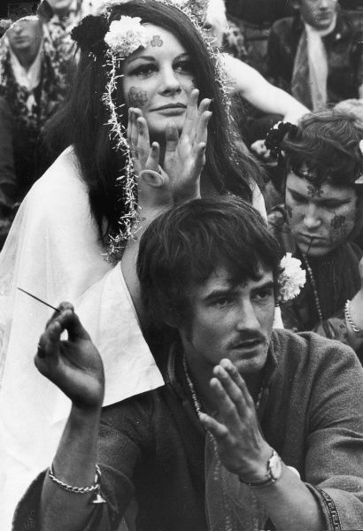 HIPPIES The perfect hippy couple, both wearing flowers in their hair at the Love-In at Woburn Park, Bedfordshire, England. Date: August 1967