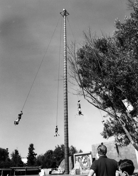 'Flying Indians' performing a bungy jump style show at Universal Studios, California, U.S.A. Date: 1960s